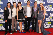 Actors (L-R) Tyler Posey, Dylan O'Brien, Crystal Reed, Tyler Hoechlin Colton Haynes and Holland Roden arrive at the 2011 MTV Movie Awards at Universal Studios' Gibson Amphitheatre on June 5, 2011 in Universal City, California.  (Photo by Jason Merritt/Getty Images),