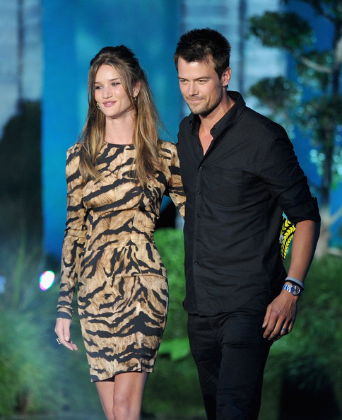 Actress Rosie Huntington-Whiteley and actor Josh Duhamel speak onstage during the 2011 MTV Movie Awards at Universal Studios' Gibson Amphitheatre on June 5, 2011 in Universal City, California.
