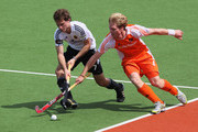 Oskar Deecke of Germany (L) and Klaas Vermeulen of Netherlands in action uring the match between Germany and Netherlands on day two of the 2011 Men's Champions Trophy on December 5, 2011 in Auckland, New Zealand.