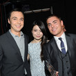 He celebrates victory with Jim Parsons and Miranda Cosgrove.