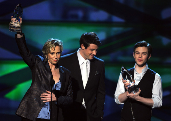 (L-R) Actors Jane Lynch accepts the Favorite TV Comedy Actress award from Cory Monteith and Chris Colfer onstage during the 2011 People's Choice Awards at Nokia Theatre L.A. Live on January 5, 2011 in Los Angeles, California.