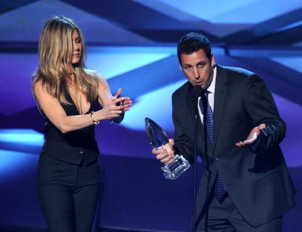 Actress Jennifer Aniston presents the Favorite Comedy Movie award to actor Adam Sandler onstage during the 2011 People's Choice Awards at Nokia Theatre L.A. Live on January 5, 2011 in Los Angeles, California.