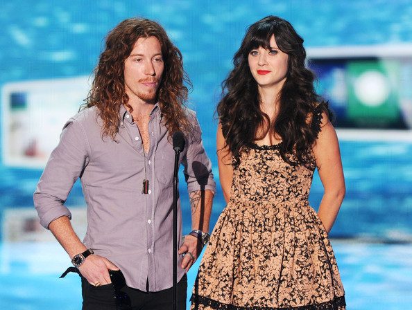 Professional snowboarder Shaun White (L) and actress Zooey Deschanel speak onstage during the 2011 Teen Choice Awards held at the Gibson Amphitheatre on August 7, 2011 in Universal City, California.