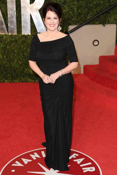 Actress Megan Mullally arrives at the Vanity Fair Oscar party hosted by Graydon Carter held at Sunset Tower on February 27, 2011 in West Hollywood, California.