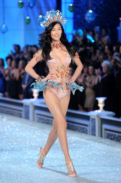 Model Liu Wen walks the runway during the 2011 Victoria's Secret Fashion Show at the Lexington Avenue Armory on November 9, 2011 in New York City.