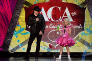 Hosts Trace Adkins (L) and Kristin Chenoweth speak onstage during the 2012 American Country Awards at the Mandalay Bay Events Center on December 10, 2012 in Las Vegas, Nevada.