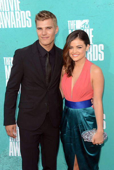 Actors Chris Zylka (L) and Lucy Hale arrive at the 2012 MTV Movie Awards held at Gibson Amphitheatre on June 3, 2012 in Universal City, California.