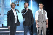 (L-R) Actors Gary Oldman, Christian Bale, and Joseph Gordon-Levitt speak onstage during the 2012 MTV Movie Awards held at Gibson Amphitheatre on June 3, 2012 in Universal City, California.