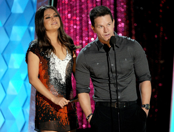 Actors Mila Kunis (L) and Mark Wahlberg present an award onstage during the 2012 MTV Movie Awards held at Gibson Amphitheatre on June 3, 2012 in Universal City, California.