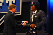 Dont'a Hightower of Alabama greets NFL Commissioner Roger Goodell after he was selected #25 overall by the New England Patriots in the first round of the 2012 NFL Draft at Radio City Music Hall on April 26, 2012 in New York City.