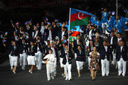Elnur Mammadli of the Azerbaijan Olympic judo team carries his country's flag during the Opening Ceremony of the London 2012 Olympic Games at the Olympic Stadium on July 27, 2012 in London, England.
