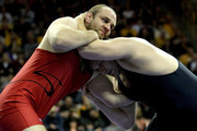 Tervel Dlagnev (red) wrestles Les Sigman (blue) in the 120 kg freestyle weight class during the finals of the US Wrestling Olympic Trials at Carver Hawkeye Arena on April 22, 2012 in Iowa City, Iowa.