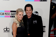 Singer Wayne Newton (R) and Kathleen McCrone attend the 2013 American Music Awards at Nokia Theatre L.A. Live on November 24, 2013 in Los Angeles, California.