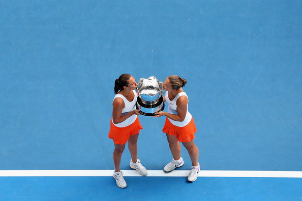 Roberta Vinci and Sara Errani of Italy pose with the championship trophy after winning their doubles final match against Ashleigh Barty and Casey Dellacqua of Australia during day twelve of the 2013 Australian Open at Melbourne Park on January 25, 2013 in Melbourne, Australia.