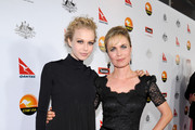 Actors Penelope Mitchell and Radha Mitchell arrive at the 2013 G'Day USA Los Angeles Black Tie Gala at JW Marriott Los Angeles at L.A. LIVE on January 12, 2013 in Los Angeles, California.