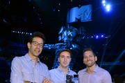 """Artist KAWS, designer of the 2013 Moonman (Center) poses with Executive Producers Dave Sirulnick and Jesse Ignjatovic at a press conference for the 2013 MTV Video Music Awards at the Barclays Center on August 22, 2013 in the Brooklyn borough of New York City. Airing LIVE from Barclays Center on Sunday, August 25, at 9:00 p.m. ET/PT this year's """"Video Music Awards"""" will mark the 30th anniversary of the show and become the first major annual award show to take place in the borough of Brooklyn."""