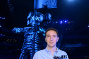 """Artist KAWS, designer of the 2013 Moonman attends a press conference for the 2013 MTV Video Music Awards at the Barclays Center on August 22, 2013 in the Brooklyn borough of New York City. Airing LIVE from Barclays Center on Sunday, August 25, at 9:00 p.m. ET/PT this year's """"Video Music Awards"""" will mark the 30th anniversary of the show and become the first major annual award show to take place in the borough of Brooklyn."""
