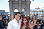 Television personality Nicole 'Snooki' Polizzi (R) with husband Jionni LaValle (L) attend the 2013 MTV Video Music Awards at the Barclays Center on August 25, 2013 in the Brooklyn borough of New York City.