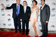 (L-R) Donald Trump, Aras Agalarov, Miss Universe 2012 Olivia Culpo and Russian singer Emin Agalarov arrive at the 2013 Miss USA pageant at Planet Hollywood Resort & Casino on June 16, 2013 in Las Vegas, Nevada.