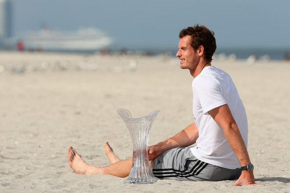 Andy Murray of Great Britain poses for photographs with the trophy on the beach after his three set victory against David Ferrer of Spain during their final match at the Sony Open at Crandon Park Tennis Center on March 31, 2013 in Key Biscayne, Florida.