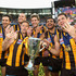 Luke Hodge Jarryd Roughead Photos - Jordan Lewis, Jarryd Roughead, Sam Mitchell, Grant Birchall, Cyril Rioli and Luke Hodge of the Hawks celebrate with the Premeirship Cup during the 2014 AFL Grand Final match between the Sydney Swans and the Hawthorn Hawks at Melbourne Cricket Ground on September 27, 2014 in Melbourne, Australia. - 2014 AFL Grand Final - Sydney v Hawthorn