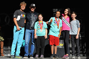Founder and chairman of Best Buddies International Anthony K. Shriver (L), Tour De France cyclist George Hincapie (2nd from L), Miss Teen USA K. Lee Graham (2nd from R) and actor Griffin Gluck (R) pose with Buddies on stage at the 2014 Audi Best Buddies Challenge on October 18, 2014 in Washington, DC.
