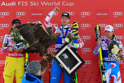 A golden eagle is displayed as (L-R) Kjetil Jansrud of Norway in second place, Hannes Reichelt of Austria in first place and Alexis Pinturault of France take the podium for the Audi FIS World Cup Men's Super G Race on the Birds of Prey course on December 6, 2014 in Beaver Creek, Colorado.