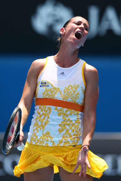 Flavia Pennetta of Italy reacts in her second round match against Monica Puig of Puerto Rica during day three of the 2014 Australian Open at Melbourne Park on January 15, 2014 in Melbourne, Australia.