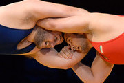 (R-L) Komeil Ghasemi of Iran wrestles Tervel Dlagnev of the United States during the 2014 FILA Freestyle Wrestling World Cup at The Forum on March 15, 2014 in Inglewood, California.