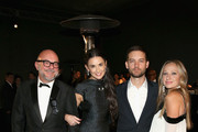 (L-R) Flower designer Eric Buterbaugh, actress Demi Moore, jewelry designer Jennifer Meyer and actor Tobey Maguire attend the 2014 LACMA Art + Film Gala honoring Barbara Kruger and Quentin Tarantino presented by Gucci at LACMA on November 1, 2014 in Los Angeles, California.