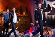(L-R) Actors Zac Efron, Dave Franco and Seth Rogen walk onstage at the 2014 MTV Movie Awards at Nokia Theatre L.A. Live on April 13, 2014 in Los Angeles, California.
