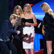She shares the stage with Josh Hutcherson and her blonde co-stars.
