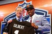 Justin Gilbert of the Oklahoma State Cowboys poses with NFL Commissioner Roger Goodell after he was picked #8 overall by the Cleveland Browns during the first round of the 2014 NFL Draft at Radio City Music Hall on May 8, 2014 in New York City.