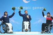 Silver medalist Taiki Morii, gold medalist Akira Kano of Japan and Bronze Caleb Brousseau of Canada during the Men's Super G Sitting Skiing during the Sochi 2014 Paralympic Games on March 9, 2014 in Sochi, Russia.
