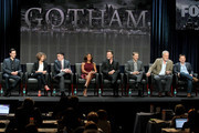 """(L-R) Actors Cory Michael Smith, Camren Bicondova, Robin Lord Taylor, Jada Pinkett Smith, Donal Logue, and Benjamin McKenzie, and producers Bruno Heller and Danny Cannon speak onstage at the """"Gotham"""" panel during the FOX Network portion of the 2014 Summer Television Critics Association at The Beverly Hilton Hotel on July 20, 2014 in Beverly Hills, California."""