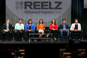 """(L-R) REELZ SVP of Development & Current Programming, Rob Swartz, TV personalities Jaafar Jackson, Donte Jackson, Genevieve Jackson, Alejandra Jackson, Jermajesty Jackson and Randy Jackson Jr. speak onstage at the """"Living With The Jacksons"""" panel during the Reelz Channel portion of the 2014 Summer Television Critics Association at The Beverly Hilton Hotel on July 12, 2014 in Beverly Hills, California."""
