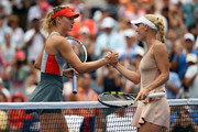 Caroline Wozniacki of Denmark meets Maria Sharapova of Russia after winning their women's singles fourth round match on Day Seven of the 2014 US Open at the USTA Billie Jean King National Tennis Center on August 31, 2014 in the Flushing neighborhood of the Queens borough of New York City.