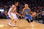 Guard Courtney Vandersloot #22 of the Chicago Sky drives against guard Diana Taurasi #3 of the Phoenix Mercury in the second half during game one of the WNBA Finals at US Airways Center on September 7, 2014 in Phoenix, Arizona. The Mercury won 83-62. NOTE TO USER: User expressly acknowledges and agrees that, by downloading and or using this photograph, User is consenting to the terms and conditions of the Getty Images License Agreement.