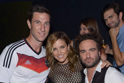 (L-R) Actors Pablo Schreiber, Sophia Bush and Johnny Galecki attend the after party for the 2014 IHeartRadio Music Festival at Haze Nightclub at the Aria Resort & Casino on September 20, 2014 in Las Vegas, Nevada.