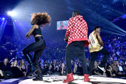 Recording artist Jason Derulo (R) performs onstage during the 2014 iHeartRadio Music Festival at the MGM Grand Garden Arena on September 19, 2014 in Las Vegas, Nevada.