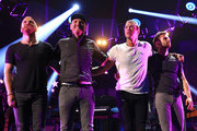 (L-R) Musicians Will Champion, Jonny Buckland, Chris Martin, and Guy Berryman of Coldplay perform onstage during the 2014 iHeartRadio Music Festival at the MGM Grand Garden Arena on September 19, 2014 in Las Vegas, Nevada.