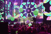(L-R) Guitarist Jonny Buckland, singer Chris Martin, drummer Will Champion and bassist Guy Berryman of Coldplay  perform onstage during the 2015 American Music Awards at Microsoft Theater on November 22, 2015 in Los Angeles, California.