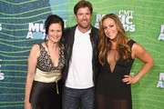 Senior Vice President of Music Strategy for CMT Leslie Fram and Noah Galloway attend the 2015 CMT Music awards at the Bridgestone Arena on June 10, 2015 in Nashville, Tennessee.