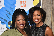 DJ Tiff McFierce (L) and actress Gabrielle Union pose backstage during the 2015 Essence Street Style Block Party on September 13, 2015 in New York City.