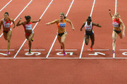 Dafne Schippers of Netherlands (C) crosses the line to win gold ahead of silver medallist Dina Asher-Smith of Great Britain & Northern Ireland (2R) and bronze medallist Verena Sailer of Germany (R) the Women's 60 metres Final during day three of the 2015 European Athletics Indoor Championships at O2 Arena on March 8, 2015 in Prague, Czech Republic.
