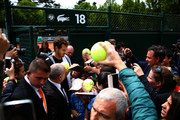 Andy Murray of Great Britain signs autographs for fans as he leaves a practice session on day six of the 2015 French Open at Roland Garros on May 29, 2015 in Paris, France.