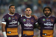 (L-R) Justin Hodges of the Broncos, Corey Parker of the Broncos and Sam Thaiday of the Broncos sing the national anthem before the 2015 NRL Grand Final match between the Brisbane Broncos and the North Queensland Cowboys at ANZ Stadium on October 4, 2015 in Sydney, Australia.