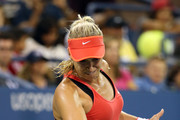 Sabine Lisicki of Germany returns a shot to Barbora Strycova of Czech Republic during their Women's Singles Third Round match on Day Six of the 2015 US Open at the USTA Billie Jean King National Tennis Center on September 5, 2015 in the Flushing neighborhood of the Queens borough of New York City.
