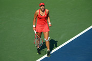 Sabine Lisicki of Germany reacts against Simona Halep of Romania during their Women's Singles Fourth Round match on Day Eight of the 2015 US Open at the USTA Billie Jean King National Tennis Center on September 7, 2015 in the Flushing neighborhood of the Queens borough of New York City.