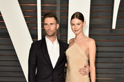 Recording artist Adam Levine (L) and model Behati Prinsloo attend the 2015 Vanity Fair Oscar Party hosted by Graydon Carter at Wallis Annenberg Center for the Performing Arts on February 22, 2015 in Beverly Hills, California.